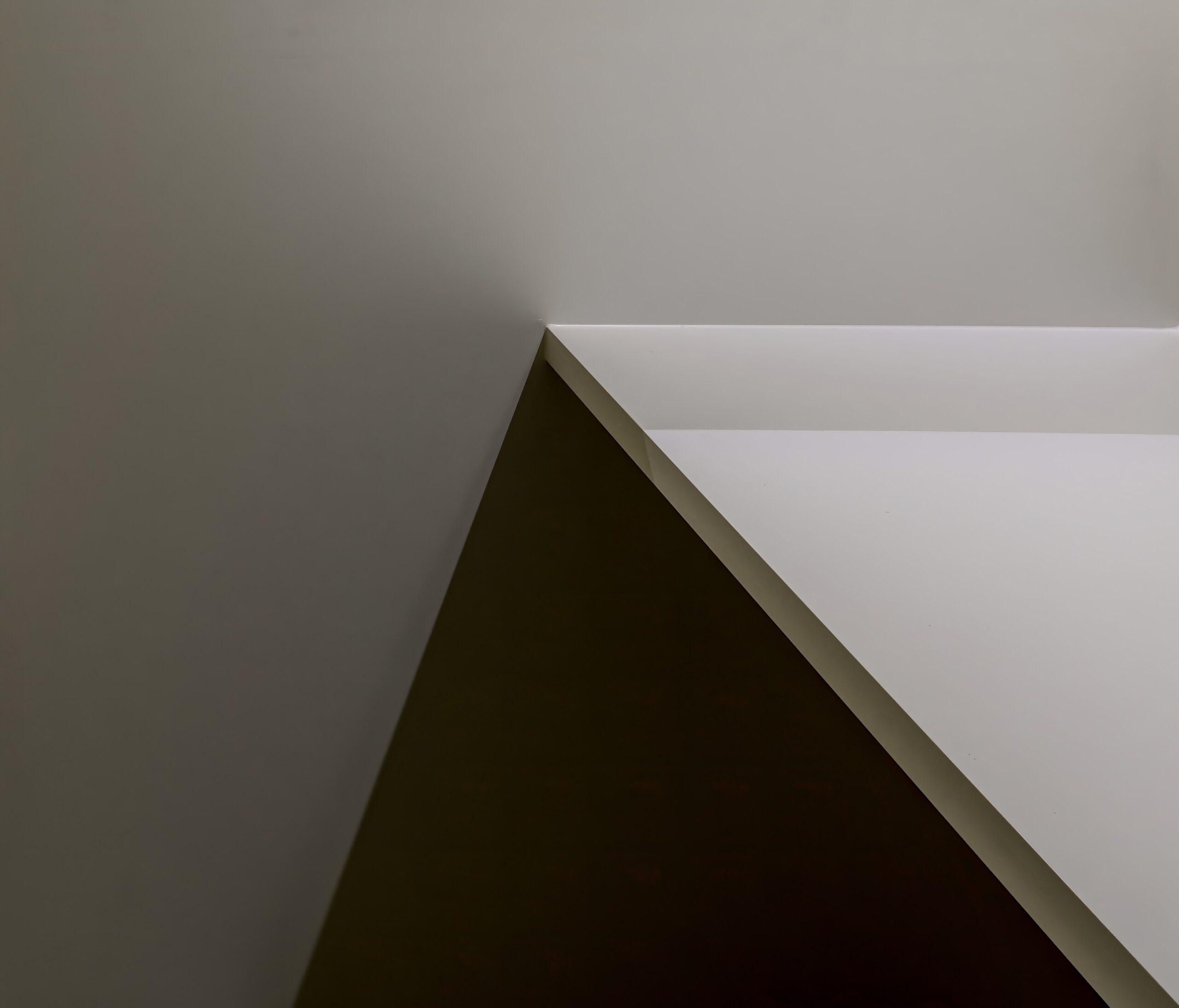 white wooden wall mounted shelf